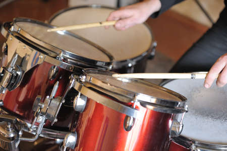 bass drum: The drummer in action. A photo close up process play on a musical instrument Stock Photo