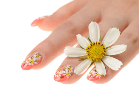 Female hand and flower. Nails with figure of a camomile Stock Photo - 7806776