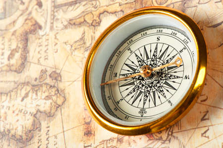 old world: Old compass on ancient map. A compass with the antique image of a direction