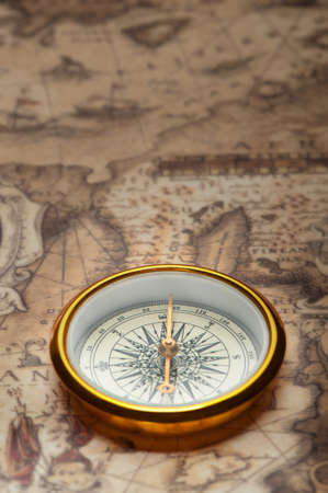 Old compass on ancient map. A compass with the antique image of a direction photo