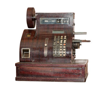 Ancient cash register. It is isolated on a white background photo