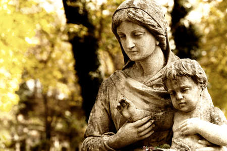 virgin girl: Monument of the woman with the child on a cemetery. Since its creation in 1787 Lychakiv Cemetery Lvov, Ukraine