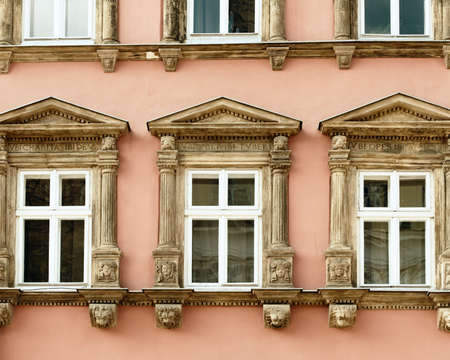 old building: Facade of a building with windows. The building is constructed 1850-1890