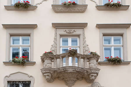 Facade of a building with a balcony and flowers. The building is constructed 1850-1890 photo