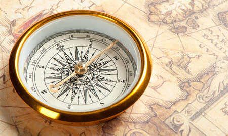 map compass: Old compass on ancient map. A compass with the antique image of a direction