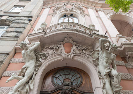 atlantes: Statues of the man supporting a balcony. Lvov. Ukraine Stock Photo