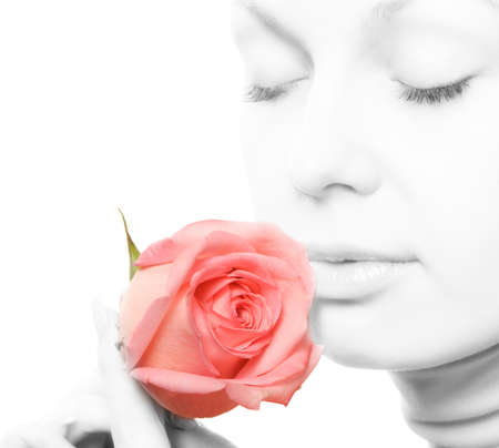 The woman with a rose close up. The monochrome image of the woman and a color rose photo