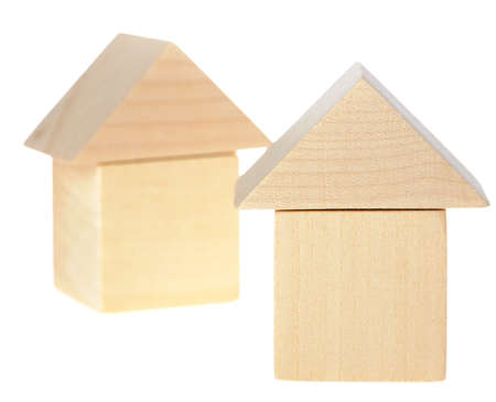 The wooden house. Children's toys - wooden cubes. It is isolated on a white background Stock Photo - 8251214