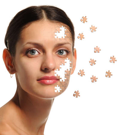 Female face close up and details puzzle. It is isolated on a white background photo