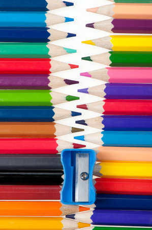 Fastener from color pencils. Abstract concept photo