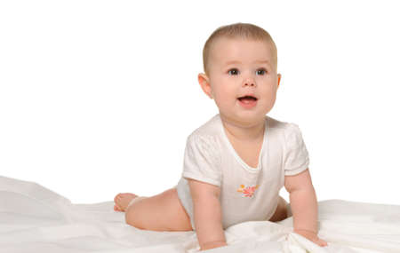 bedsheet: The baby on a bedsheet. Age of 8 months. It is isolated on a white background Stock Photo