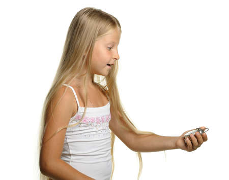 beat the clock: To be late. The girl with amazement looks at an alarm clock. It is isolated on a white background