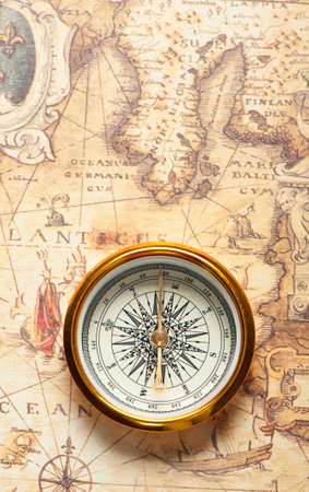 Old compass on ancient map. A compass with the antique image of a direction Stock Photo - 8794089