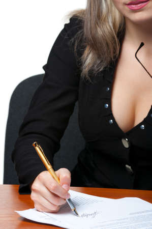 The business woman signs the contract.Photo closeup. It is isolated on the white background. photo