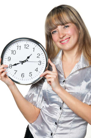 The business woman with clock in hands. It is isolated on a white background photo