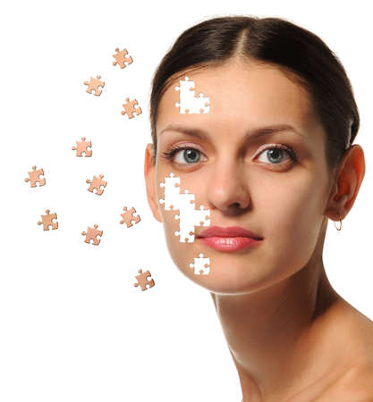 perfection: Female face close up and details puzzle. It is isolated on a white background