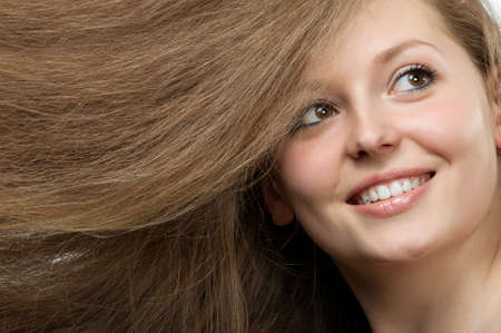 Healthy beautiful long hair closeup in motion created by wind. Portrait Stock Photo - 9223304