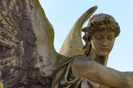 praying angel: Monument to an angel on a cemetery. Since its creation in 1787 Lychakiv Cemetery Lvov, Ukraine Stock Photo