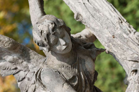 Tombstone an angel with a cross. Lychakiv Cemetery Lvov, Ukraine. photo