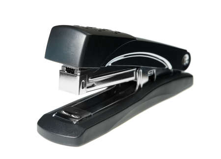 fastens: Stapler.Mechanical device which fastens papers and other material together by means of staples. It is isolated on a white background