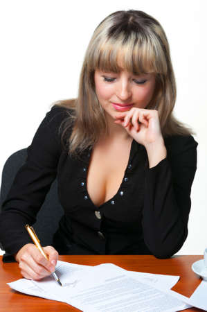 The business woman signs the contract. It is isolated on the white background. photo