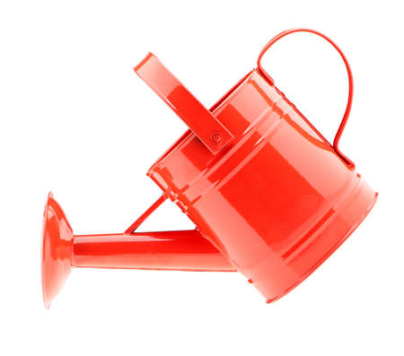water can: Red watering can. It is isolated on a white background