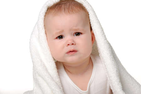 to cry: The crying baby under a towel. Age of 8 months. It is isolated on a white background