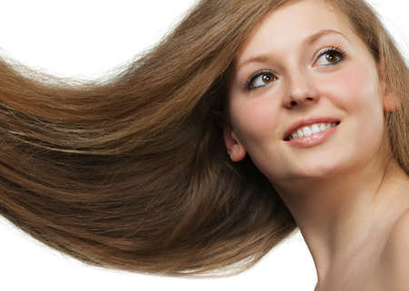 Healthy beautiful long hair closeup in motion created by wind. Portrait photo