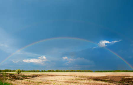 Rainbow. A landscape with a rain and a rainbow. Stock Photo - 9582543