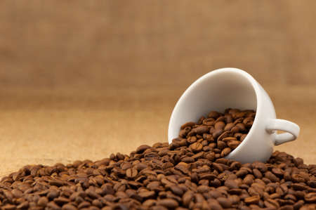 White cup with coffee grains. Grunge background Stock Photo - 9966513