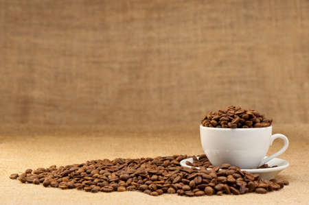 White cup with coffee grains. Grunge background Stock Photo - 9966376