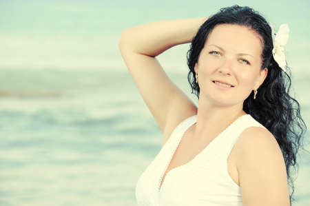 sundress: The woman in a white sundress on seacoast. Warm toned image Stock Photo