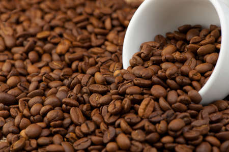 hot coffees: White cup with coffee grains. A photo close up Stock Photo