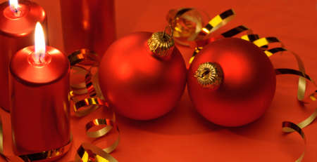 candles in dark: Christmas candles and red spheres. A celebratory composition