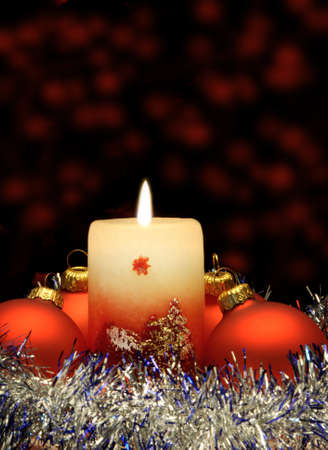 Christmas candle and red spheres. A celebratory composition Stock Photo