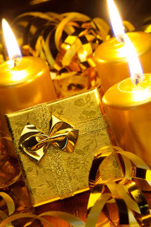Christmas candles and gift boxes. Gold color Reklamní fotografie