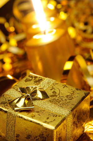 Christmas candles and gift boxes. Gold color Stock Photo
