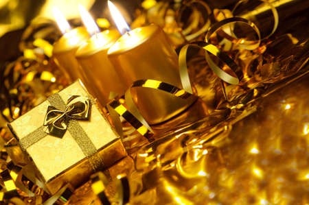 candlelight: Christmas candles and gift boxes. Gold color Stock Photo