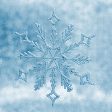 fall winter: Snowflake big close up. Bokeh a background. Toning is blue Stock Photo