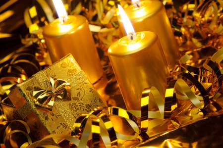 Christmas candles and gift boxes. Gold color Stock Photo - 10588845