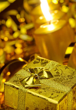 Christmas candles and gift boxes. Gold color Stock Photo - 10588842