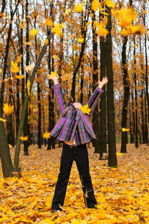 lifted hands: The girl with the lifted hands autumn forest. Falling yellow leaf