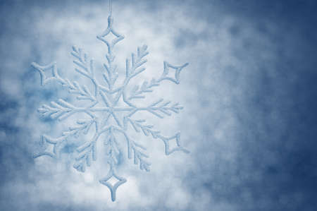 holiday lighting: Snowflake big close up. Bokeh a background. Toning is blue Stock Photo