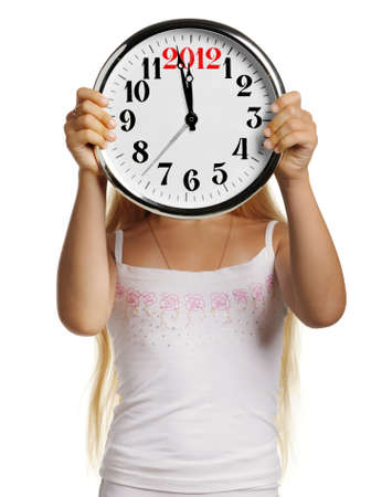 The girl hold in hands a big clock with figures 2012. It is isolated on a white background Stock Photo - 10588827