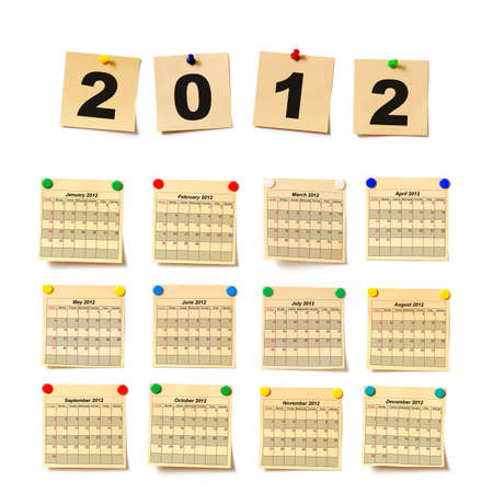 calendar on set note 2012. Paper a note attached to a wall buttons, it is isolated on a white background photo