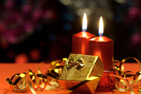 candlelight: Christmas candles and gift boxes. A celebratory composition Stock Photo