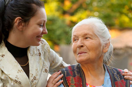 grand daughter: The grandmother with the grand daughter. A photo on outdoors Stock Photo
