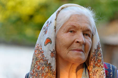Portrait of the elderly woman. A photo on outdoors Stock Photo - 10695061