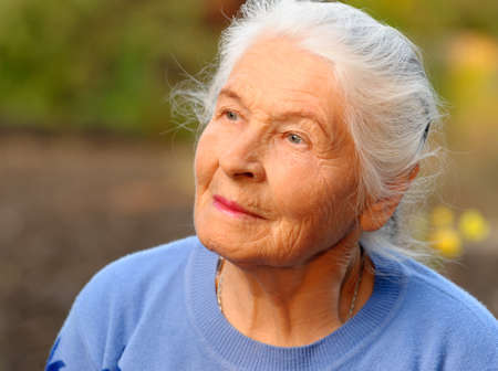 Portrait of the elderly woman. A photo on outdoors Stock Photo - 10695051