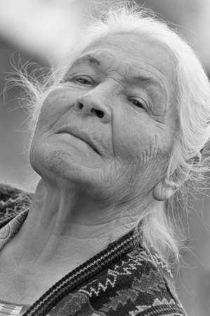 Portrait of the elderly woman. Monochrome. A photo on outdoors photo